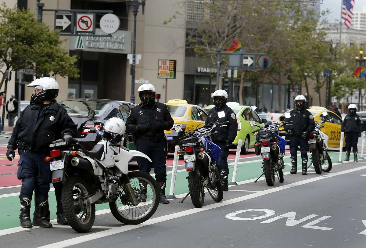 There was a strong police presence in the area of Market and 11th Streets Monday June 22, 2015. A protest against Uber on Market Street in San Francisco, Calif. drew several dozen taxi drivers and their supporters near where the National Conference of Mayors was taking place.