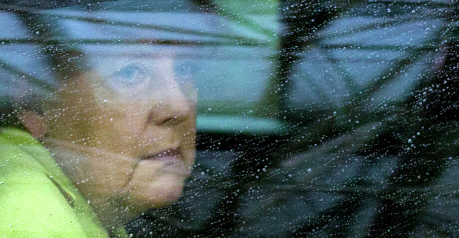 German Chancellor Angela Merkel arrives for an EU summit at the European Council building in Brussels on Monday, June 22, 2015. Heads of state in the eurogroup meet in Brussels Monday for a special summit to discuss the financial crisis with Greece. (AP Photo/Michel Euler) Photo: Michel Euler, STF / AP