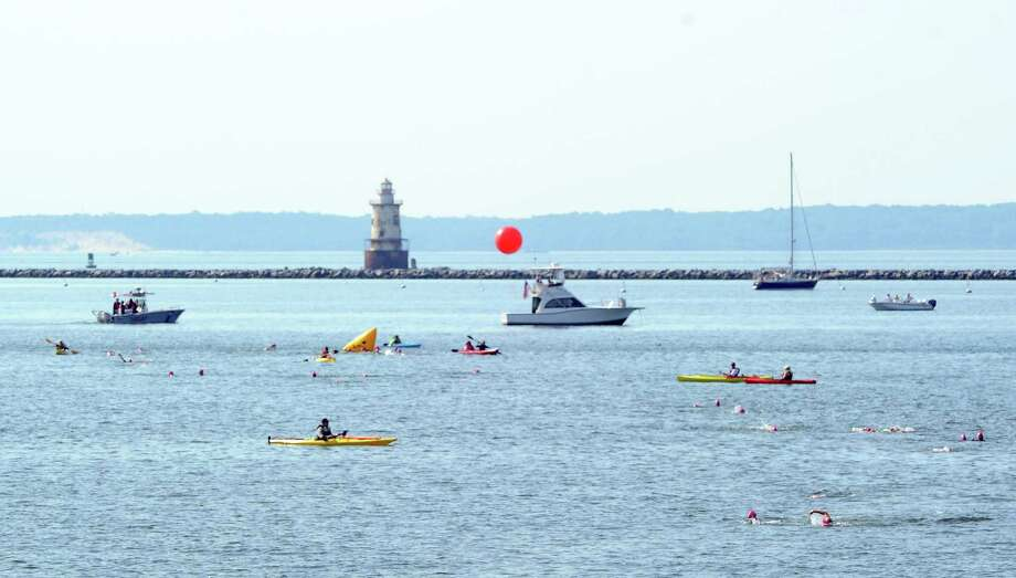 Swimmers take to the water off Stamford in the 2013 Swim Across America event for the Greenwich-Stamford area. Photo: Bob Luckey / Bob Luckey / Greenwich Time