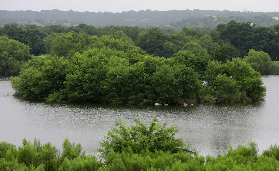 A small island at a body of water north of Wurzbach Parkway between West Avenue and Blanco Road has been less visible as the water level has been rising since last week's consistent rainfall. Photo: John Davenport, Staff / San Antonio Express-News / ©San Antonio Express-News/John Davenport