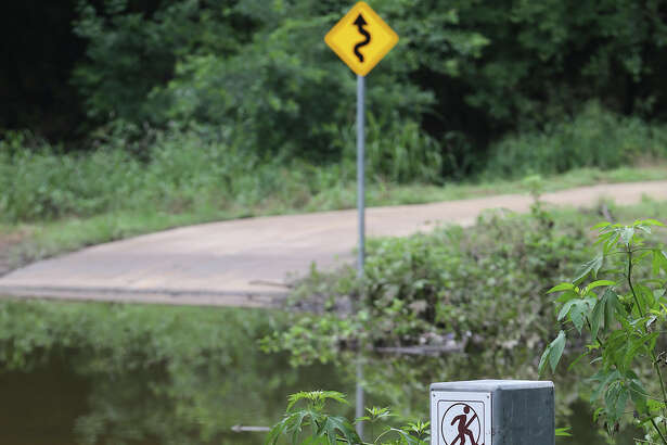 Trails on the Salado Creek Greenway are still partially submerged Monday June 22, 2015 after consistent rainfall in the San Antonio area.