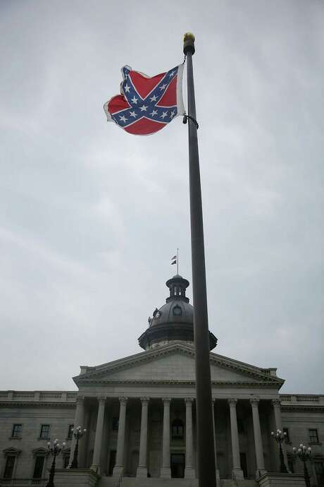 State officials in 2000 decided to move the Confederate flag from the State House dome to a pole in in front of the building. Photo: Joe Raedle / Getty Images / 2015 Getty Images