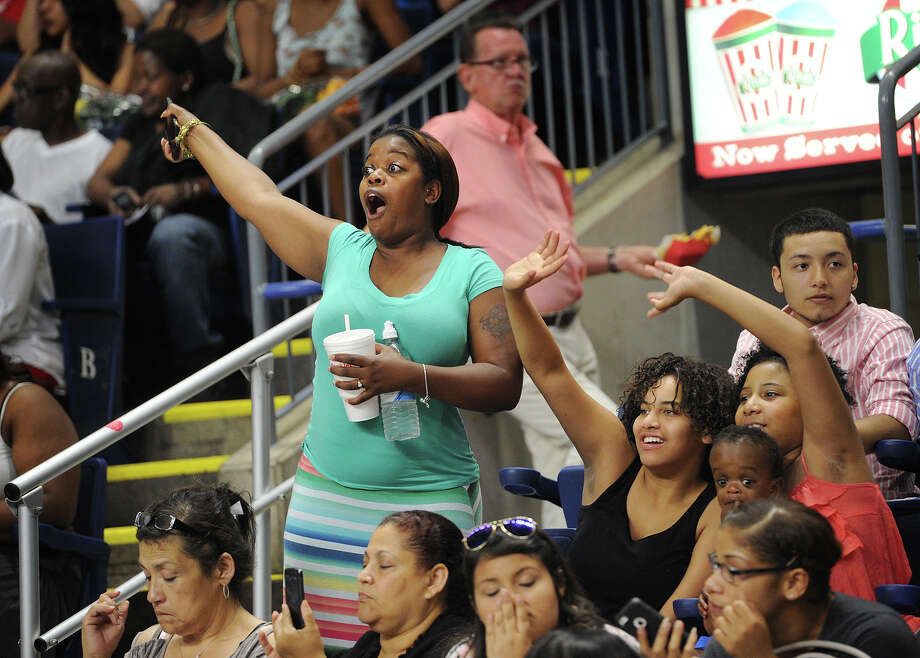 Family members cheer graduates during their entrance to the Harding High School Graduation at the Webster Bank Arena in Bridgeport, Conn. on Monday, June 22, 2015. Photo: Brian A. Pounds, Hearst Connecticut Media / Connecticut Post