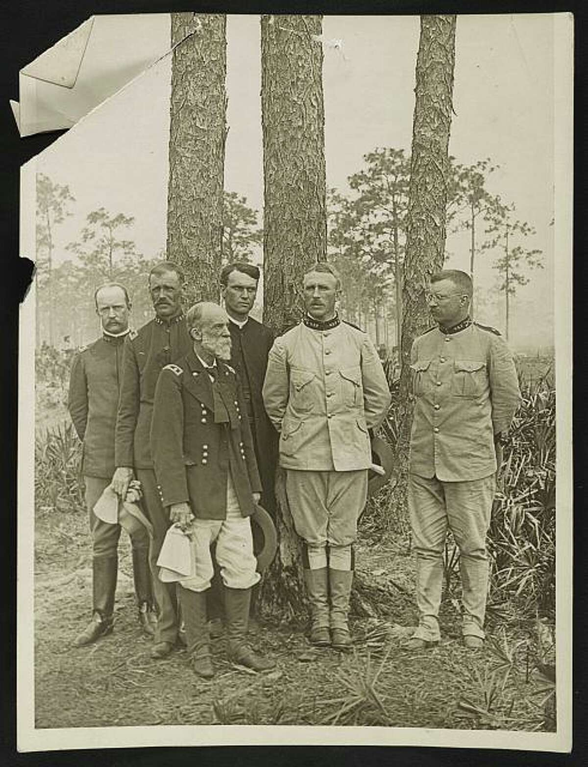 Wheeler, now a U.S. Army general, commanded all cavalry troops in Cuba in the Spanish-American War. Theodore Roosevelt is at far right.