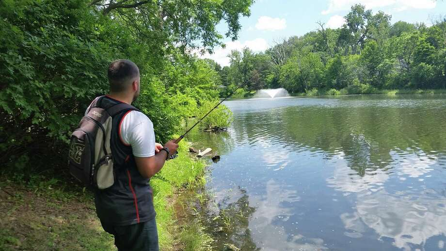 Josh Goebel of Albany fishes Wednesday, June 22, at Buckingham Pond in Albany. (Chris Churchill / Times Union)