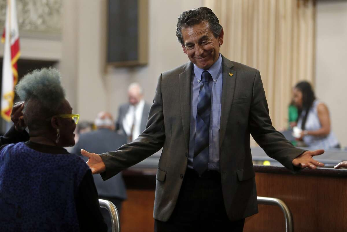 Councilmember Noel Gallo talks to an audience member before a special meeting of the Oakland City Council to hear comments and discuss 2015-2017 budget in Oakland, Calif., on Monday, June 22, 2015.