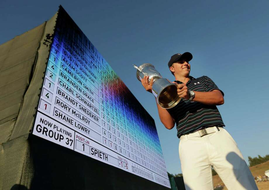 Jordan Spieth holds up the trophy after winning the U.S. Open golf tournament at Chambers Bay on Sunday, June 21, 2015 in University Place, Wash. (AP Photo/Charlie Riedel) ORG XMIT: WACC247 Photo: Charlie Riedel / AP