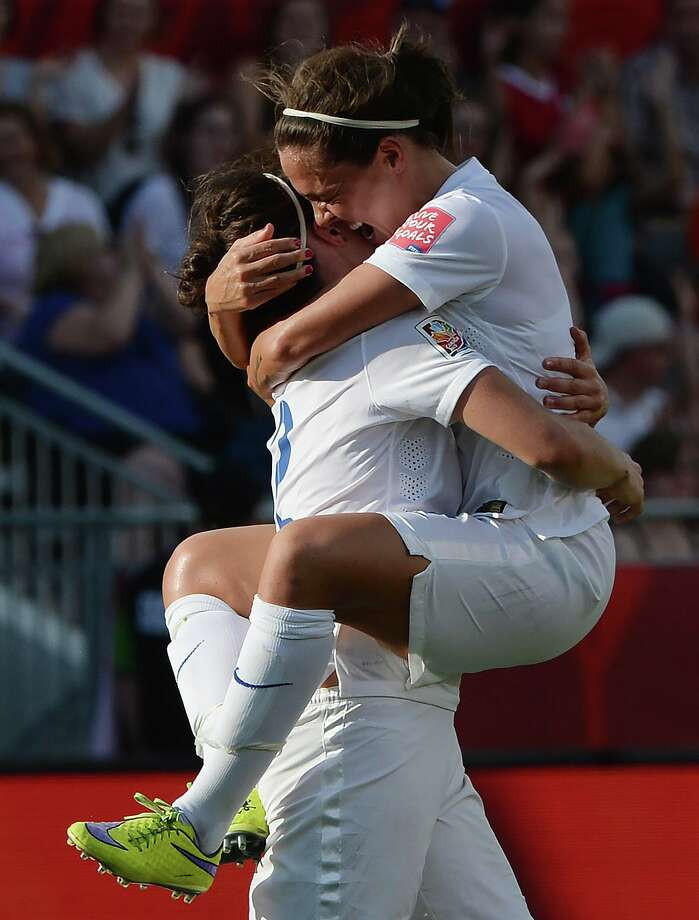 England's Lucy Bronze, left, and Fara Williams celebrate Bronze's goal against Norway during second half FIFA Women's World Cup round of 16 soccer action in Ottawa, Ontario, Canada, on Monday, June 22, 2015. (Sean Kilpatrick/The Canadian Press via AP) MANDATORY CREDIT ORG XMIT: SKP518 Photo: Sean Kilpatrick / CP