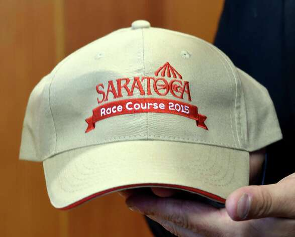 One of the giveaways for the 2015 meeting of the Saratoga Race course is a baseball cap which was previewed during a press briefing Monday June 22, 2015 at the Fasig Tipton pavilion in Saratoga Springs, N.Y.    (Skip Dickstein/Times Union) Photo: SKIP DICKSTEIN / 00032328A
