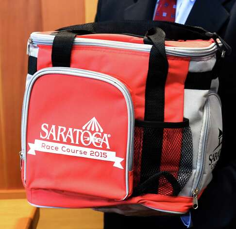 One of the giveaways for the 2015 meeting of the Saratoga Race course is a cooler bag which was previewed during a press briefing Monday June 22, 2015 at the Fasig Tipton pavilion in Saratoga Springs, N.Y.    (Skip Dickstein/Times Union) Photo: SKIP DICKSTEIN / 00032328A