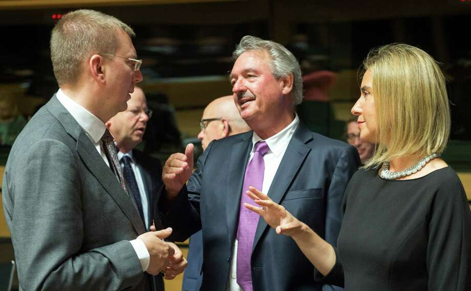 Luxembourg's Foreign Minister Jean Asselborn, center, speaks with Latvian Foreign Minister Edgars Rinkevics, left, and European Union High Representative Federica Mogherini during a meeting of EU foreign ministers at the EU Council building in Luxembourg on Monday, June 22, 2015. Ministers meet on Monday to discuss among other issues, migration and Russia. (AP Photo/Charles Caratini) ORG XMIT: VLM126 Photo: Charles Caratini / AP