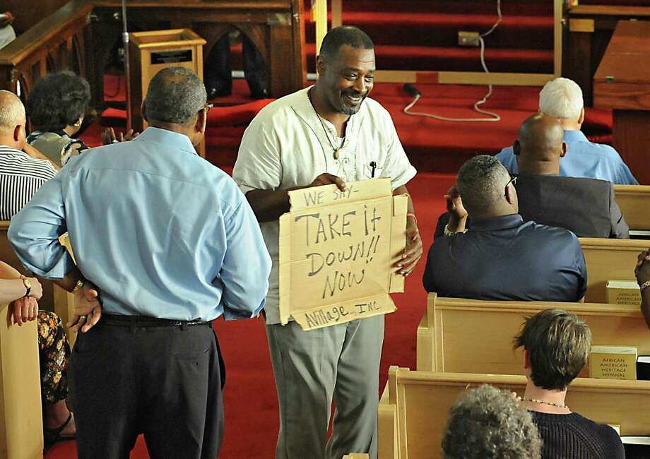 Willie White, founder of AVillage, Inc., holds a sign during a prayer vigil in the aftermath of the church shooting in Charleston, S.C. at Mount Calvary Baptist Church on Monday, June 22, 2015 in Albany, N.Y.  (Lori Van Buren / Times Union) Photo: Lori Van Buren / 00032355A