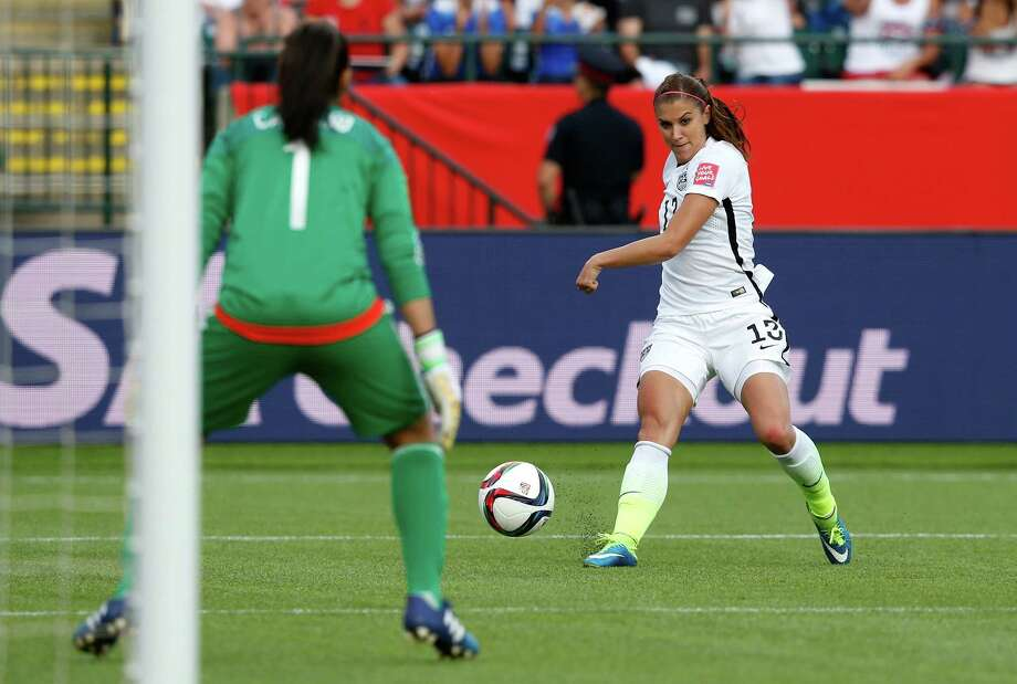 EDMONTON, AB - JUNE 22:  Alex Morgan #13 of the United States scores her first goal against goalkeeper Stefany Castano #1 of Colombia in the second half in the FIFA Women's World Cup 2015 Round of 16 match at Commonwealth Stadium on June 22, 2015 in Edmonton, Canada.  (Photo by Todd Korol/Getty Images) ORG XMIT: 528451983 Photo: Todd Korol / 2015 Getty Images