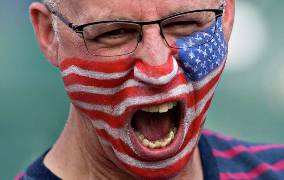 A United States fan cheers for his team before the start of FIFA Women's World Cup round of 16 action against Colombia in Edmonton, Alberta, Canada, Monday, June 22, 2015.  Photo: JASON FRANSON, Associated Press / CP