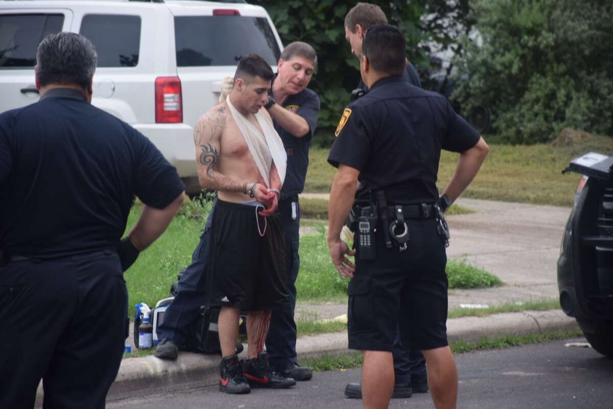 San Antonio Police say one of their officers opened fire on a suspect Tuesday morning, June 23, 2015, after nearly being run over while responding to a call of the West Side.