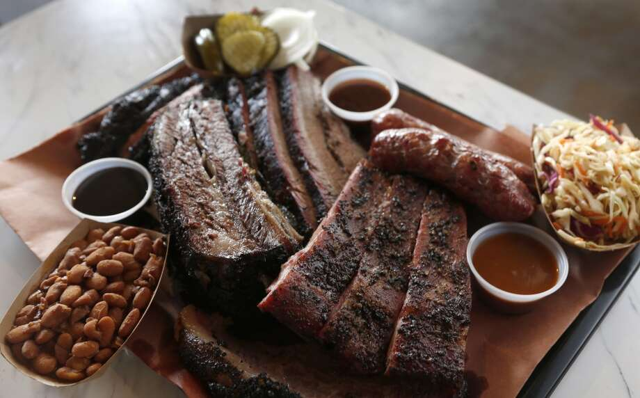 Killen's Barbecue serves a six meat plate.  Photo: Karen Warren, Houston Chronicle