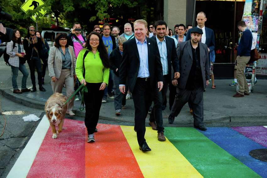 With Seattle's Pride Week kicking off, Mayor Ed Murray, center right, unveiled rainbow-colored crosswalks around Capitol Hill. Photographed Tuesday, June 23, 2015, at 10th Avenue and Pike Street.