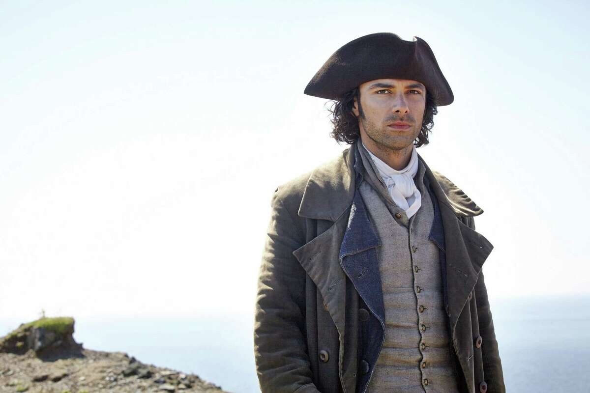 """This photo provided by Masterpiece shows Aidan Turner as Ross Poldark in the Masterpiece series, """"Poldark."""" The show premieres Sunday, June 21, 2015, at 9 p.m. EST on Masterpiece on PBS. (Robert Viglasky/Mammoth Screen for Masterpiece, PBS via AP)"""