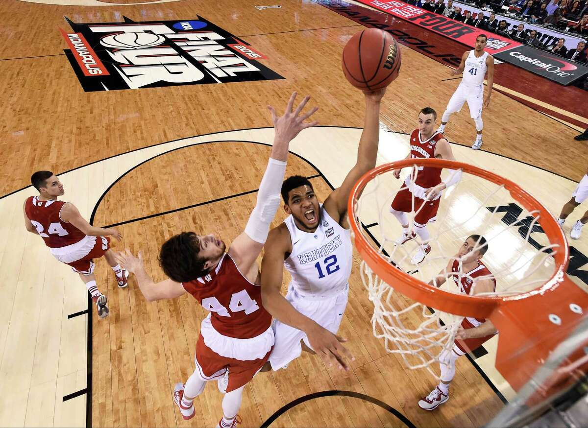 Kentucky's Karl-Anthony Towns (12) drives to the basket past Wisconsin's Frank Kaminsky (44) during the first half of the 2015 NCAA Final Four national semifinal game in Indianapolis. Small ball was the story of the NBA Finals. It might seem temporarily forgotten at the start of the NBA draft. The first three players taken Thursday, June 25, 2015, could easily be a trio of big guys, led by Kentucky's Karl-Anthony Towns.