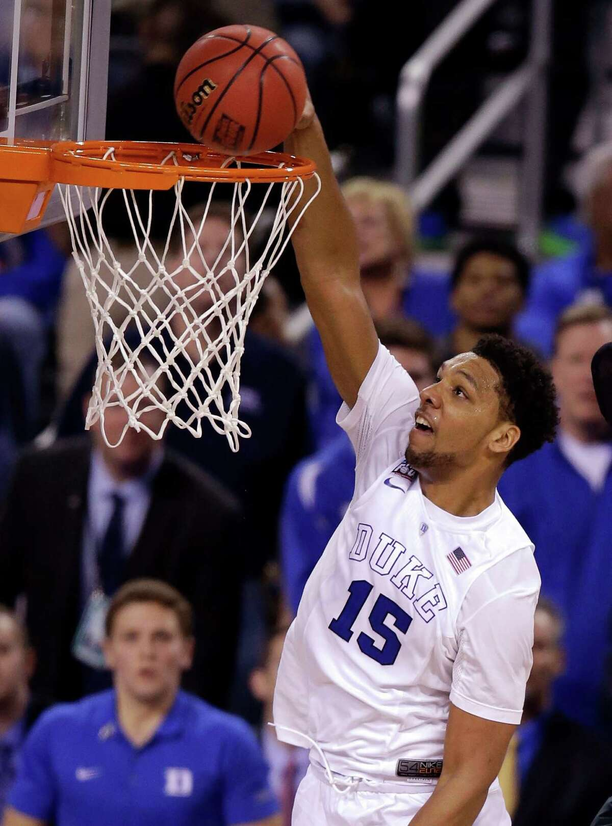 Duke's Jahlil Okafor dunks the ball against Michigan State during the second half of the NCAA Final Four national semifinal game in Indianapolis.