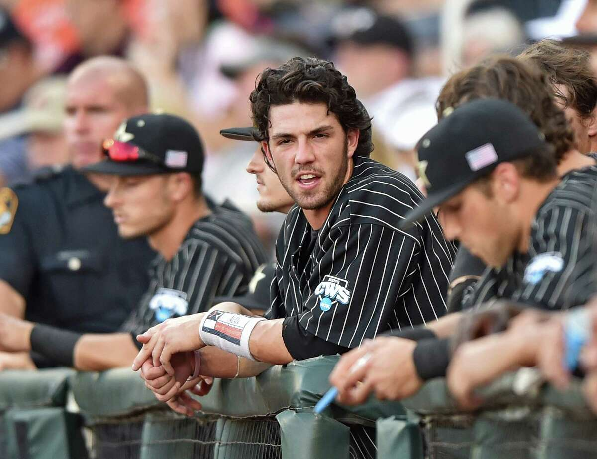 Shortstop Dansby Swanson of the Vanderbilt Commodores looks on from the dugout against of the Virginia Cavaliers in the second inning during Game 1 of the College World Series Championship Series on June 22, 2015 at TD Ameritrade Park in Omaha, Nebraska.