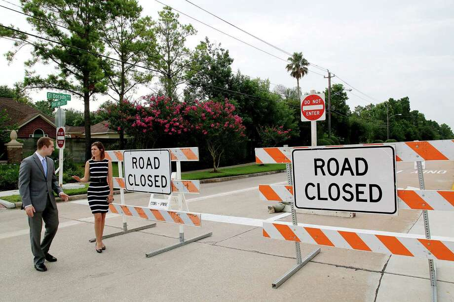 Lauren Laake and Evan Austin, staff members with Houston City Councilman Dave Martin's office, view lane changes being made at the intersection of Clear Lake City and El Dorado boulevards. Photo: Pin Lim, Freelance / Copyright Forest Photography, 2015.