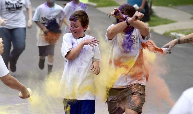 Students at School 16 in Troy are splashed with color to mark the end of a school year Monday morning, June 23, 2015, in Troy, N.Y. (Skip Dickstein/Times Union)