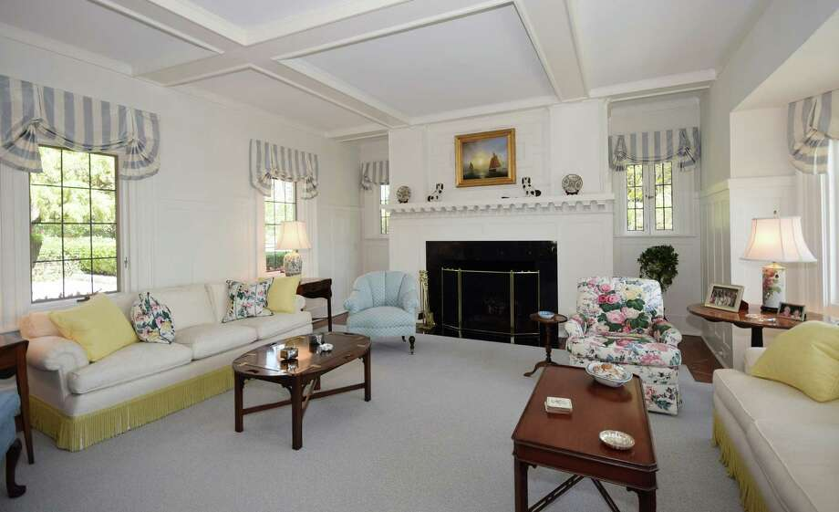 The living room at 8 Butler's Island Road in Darien, Connecticut, has a coffered ceiling coated with a sky blue hue. Photo: Contributed Photo / Darien News