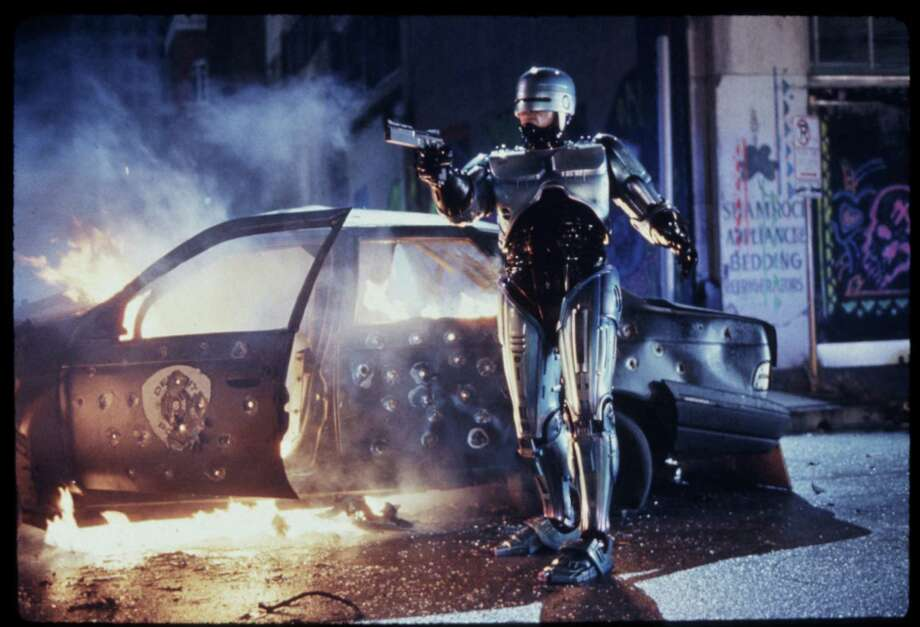 "Peter Weller as Robocop in ""Robocop 2"" which was filmed in Houston in late 1989 and early 1990. It was released to theaters 25 years ago this week.  Photo: Deana Newcomb, File / Getty  / handout slide"