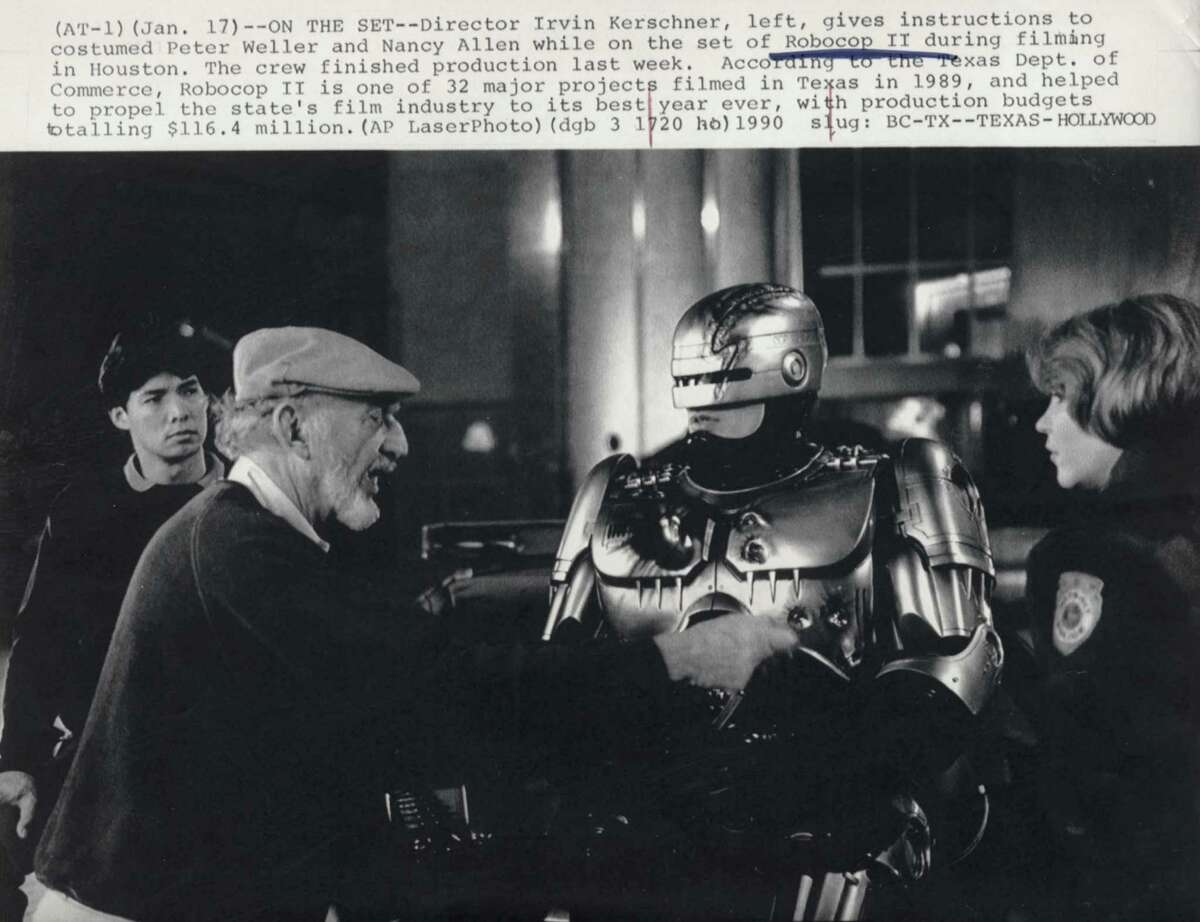 AP CAPTION: (AT01) (January 17, 1990) -- ON THE SET -- Director Irvin Kerschner, left, gives instructions to costumed Peter Weller and Nancy Allen while on the set of Robocop II during filming in Houston. The crew finished production last week. According to the Texas Dept. of Commerce, Robocop II is one of 32 major projects filmed in Texas in 1989, and helped to propel the state's film industry to its best year ever, with production budgets totalling $116.4 million. (AP LaserPhoto) 1990. slug: BC-TX--TEXAS-HOLLYWOOD. HOUCHRON CAPTION (04/08/1992): Is this the face of the warrior of the future? It just might be, according to a study conducted for the Army by a team of 100 experts assembled by the National Research Council. HOUCHRON CAPTION (06/10/2004): DIRECTOR IRVIN KERSHNER GIVES INSTRUCTIONS TO PETER WELLER AND NANCY ALLEN ON THE SET OF THE FILM ROBOCOP 2 IN A 1990 PHOTO.