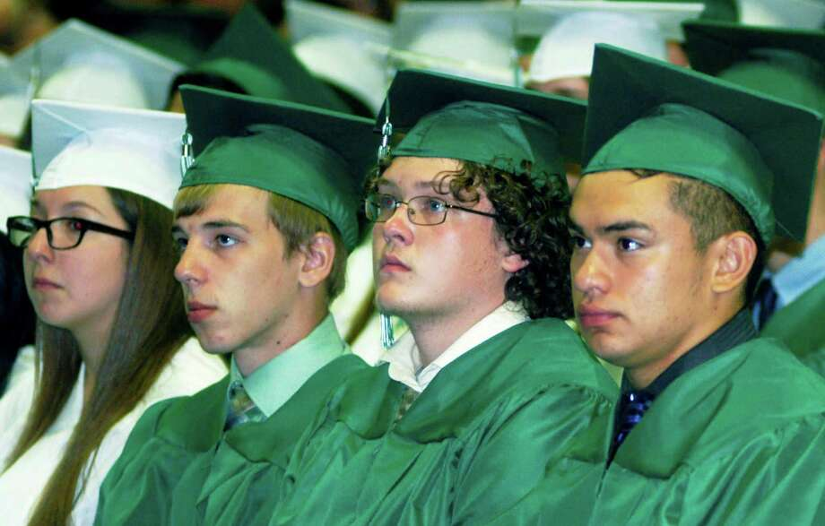 Engaged in the words of a fellow grad are, from  left to right, Alissa Assad, Zachary Arnold, Michael Armstrong and Jorge Arcuri, during the New Milford High School commencement ceremony at the O'Neill Center, on the campus of Western Connecticut State University in Danbury, June 20, 2015. Photo: Norm Cummings / Norm Cummings / The News-Times