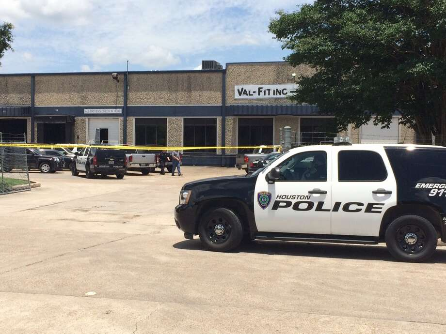 A man allegedly shot and killed his boss at a business near Mesa and Spikewood on Wednesday, June 23, 2015. (Billy Smith II / Houston Chronicle) Photo: Billy Smith II, Houston Chronicle