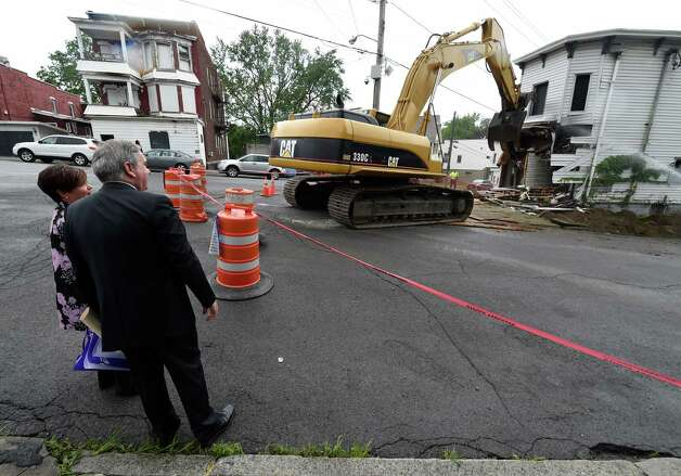 Schenectady Mayor Gary McCarthy, right is joined by City Council member Leesa Perazzo Tuesday morning June 23, 2015 as 701 Congress Street is demolished in Schenectady, N.Y.    (Skip Dickstein/Times Union) Photo: SKIP DICKSTEIN / 00032369A