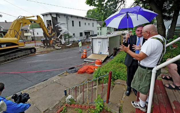Schenectady Mayor Gary McCarthy, let speaks to a neighbor Tuesday morning June 23, 2015 as 701 Congress Street is demolished in Schenectady, N.Y.    (Skip Dickstein/Times Union) Photo: SKIP DICKSTEIN / 00032369A