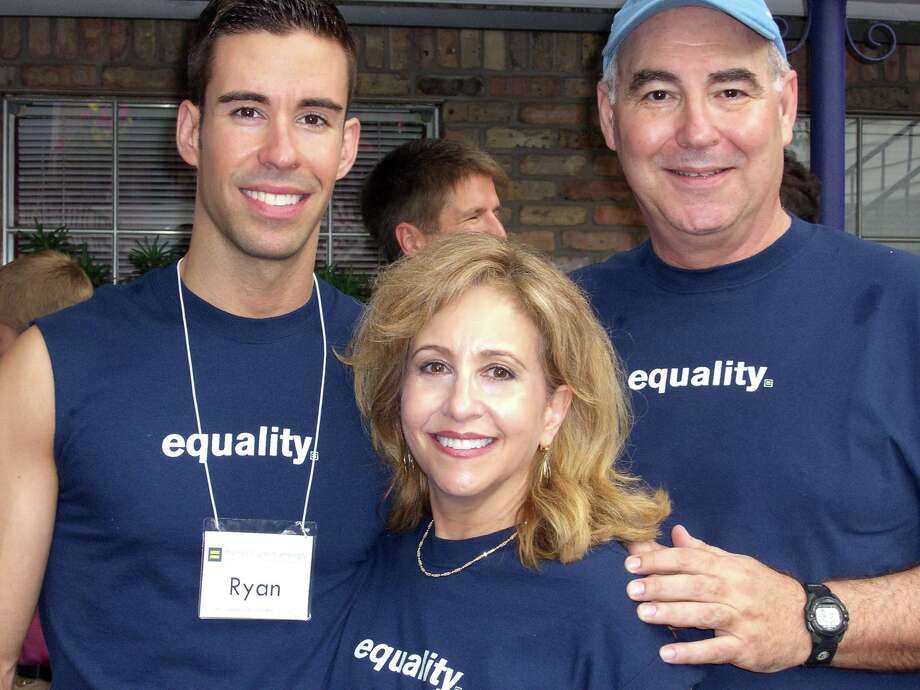 Ryan Levy, male grand marshal of Gay Pride Parade, and his parents Jerry and Gail Levy. Photo: Courtesy