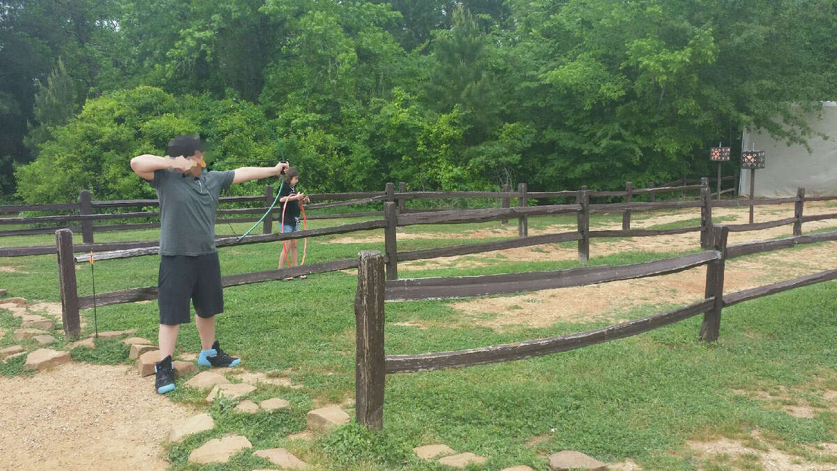 Londen's 12-year-old brother (pictured) was shooting at the Piney Shores Resort archery range when London ran down the lane and was struck in the head by an arrow on April 11, 2015. This photo shows a reenactment of that day.