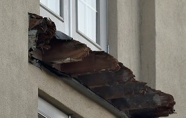 Shards of wood are all that remain at the scene where a balcony gave way (above) killing six in Berkeley, California on June 17, 2015. A second balcony (below) was removed when it was discovered to also be compromised.   Dry rot and overcrowding could be responsible for the collapse of the balcony that sent six young Irish nationals plummeting to their deaths.     AFP PHOTO / JOSH EDELSONJosh Edelson/AFP/Getty Images