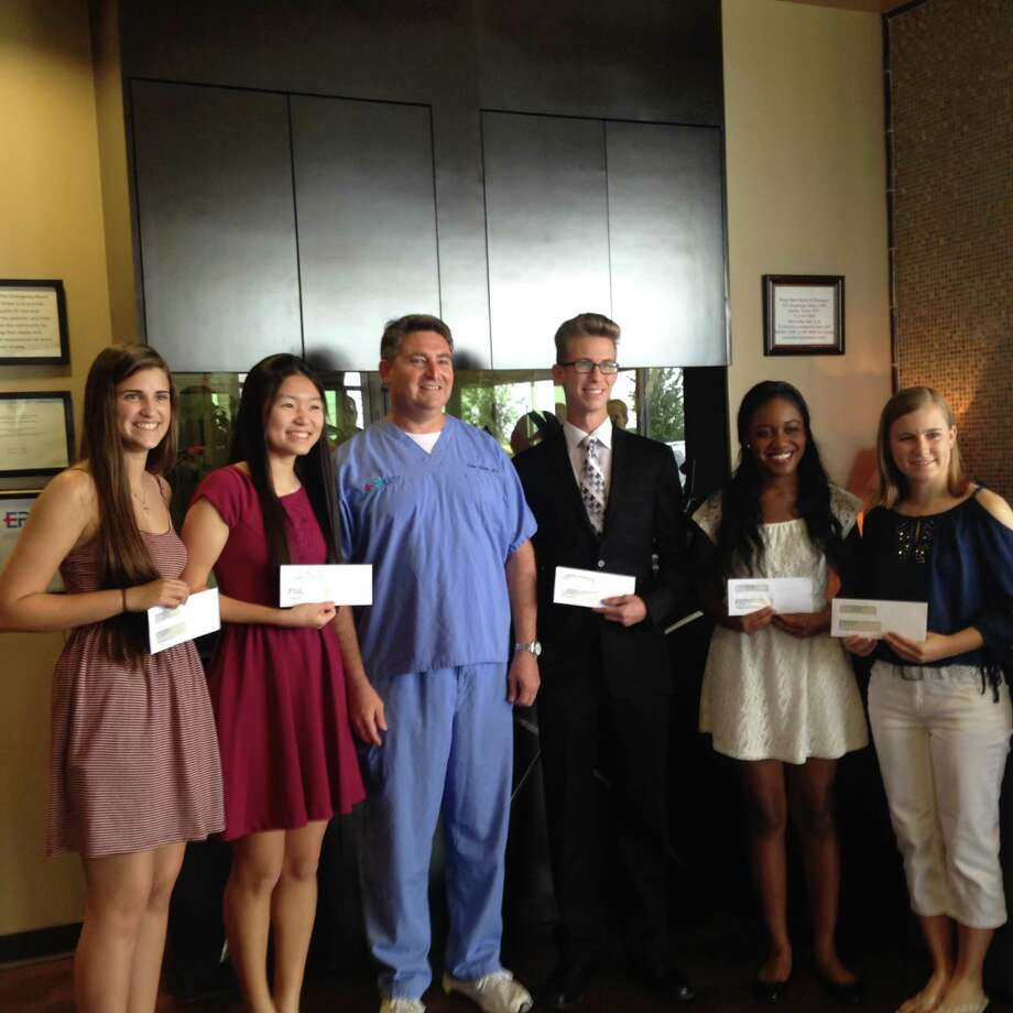 ER Katy, 25765 Katy Freeway, Katy, awarded scholarships to five graduating seniors in Katy Independent School District. From left are Kristen Lee Chadwick, Emily Zhang, Dr. Ethan Brown, Joshua Zane Gammons, Micah Simone Johnson and Casey Renee Sutton. Photo: Courtesy ER Katy