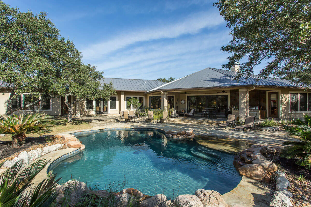 An outdoor living space and gorgeous pool are just some of the features of this home at 603 Rio Cordillera in Boerne, listed by The Graves Group at Phyllis Browning Company.