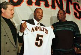 San Francisco Giants newly-signed center fielder Darryl Hamilton holds up his new jersey and number as Giants vice president and general manager Brian Sabean, left, and manager Dusty Baker, right, look on as Hamilton is introduced to the media in San Francisco, Monday Jan. 13, 1997.  Hamilton, who played with the Texas Rangers last season, signed a two-year contract with the Giants.(AP Photo/Eric Risberg)  Ran on: 10-14-2009 GM Brian Sabean with outfielder Darryl Hamilton, one of his first free-agent signings, and Dusty Baker in January 1997.