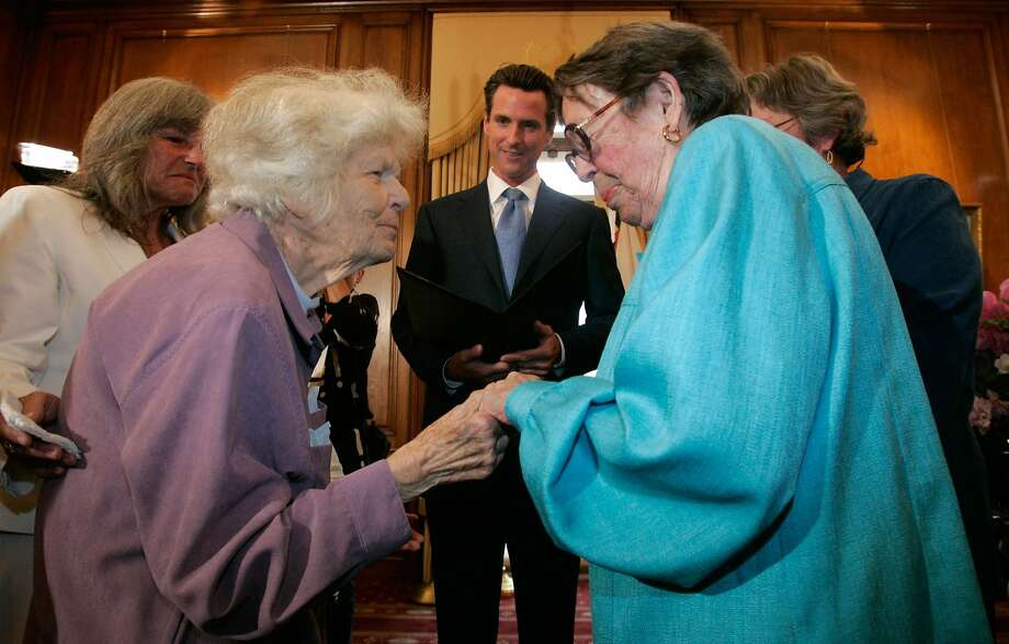 Del Martin (left) and Phyllis Lyon wed at S.F. City Hall in 2008 before then-Mayor Gavin Newsom, who forced the same-sex marriage issue into the national consciousness by granting marriage licenses to same-sex couples in 2004. Photo: Pool, Getty Images