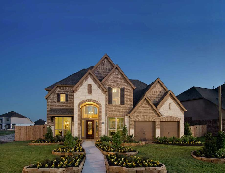 Perry Homes has opened Cane Island's first model home.  Perry Homes has opened Cane Island's first model home. Photo: Courtesy Perry Homes / BRUCE GLASS