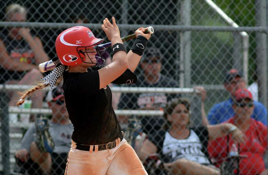 Aces Express Gold infielder/catcher and Dickinson High School sophomore Baylee Klingler drives a ball against Hotshots Gold during their game at the Summer Nationals Warm-up tournament at Imperial Park in Sugar Land last month. Photo: Jerry Baker, Freelance