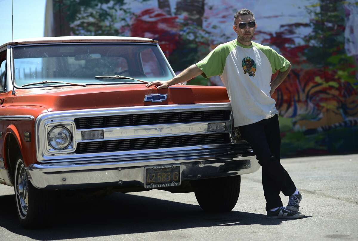 Mike Sarcona stands with his 1970 Chevrolet CST with original black license plates at Classic Cars West in Oakland, California, on Tuesday, June 23, 2015.