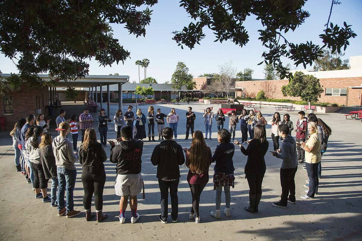 Pasadena High School students form a circle while undergoing anti-bullying training by Community Matters, a Bay Area non-profit.