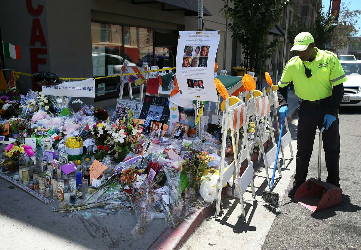Maalik Redditt sweeps the area around a memorial erected for the victims of last week's fatal balcony collapse in Berkeley, Calif. on Tuesday, June 23, 2015. Six people died after an apartment balcony they were on collapsed while the group was celebrating a friend's birthday last week.