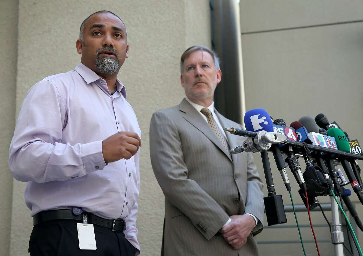 City of Berkeley spokesman Matthai Chakko (left) fields questions from reporters directed to planning director Eric Angstadt (center) who announced the city will recommend tougher regulations in building construction, during a news conference in Berkeley, Calif. on Tuesday, June 23, 2015. The new regulations come after six people died when an apartment balcony they were on collapsed while the group was celebrating a friend's birthday last week.