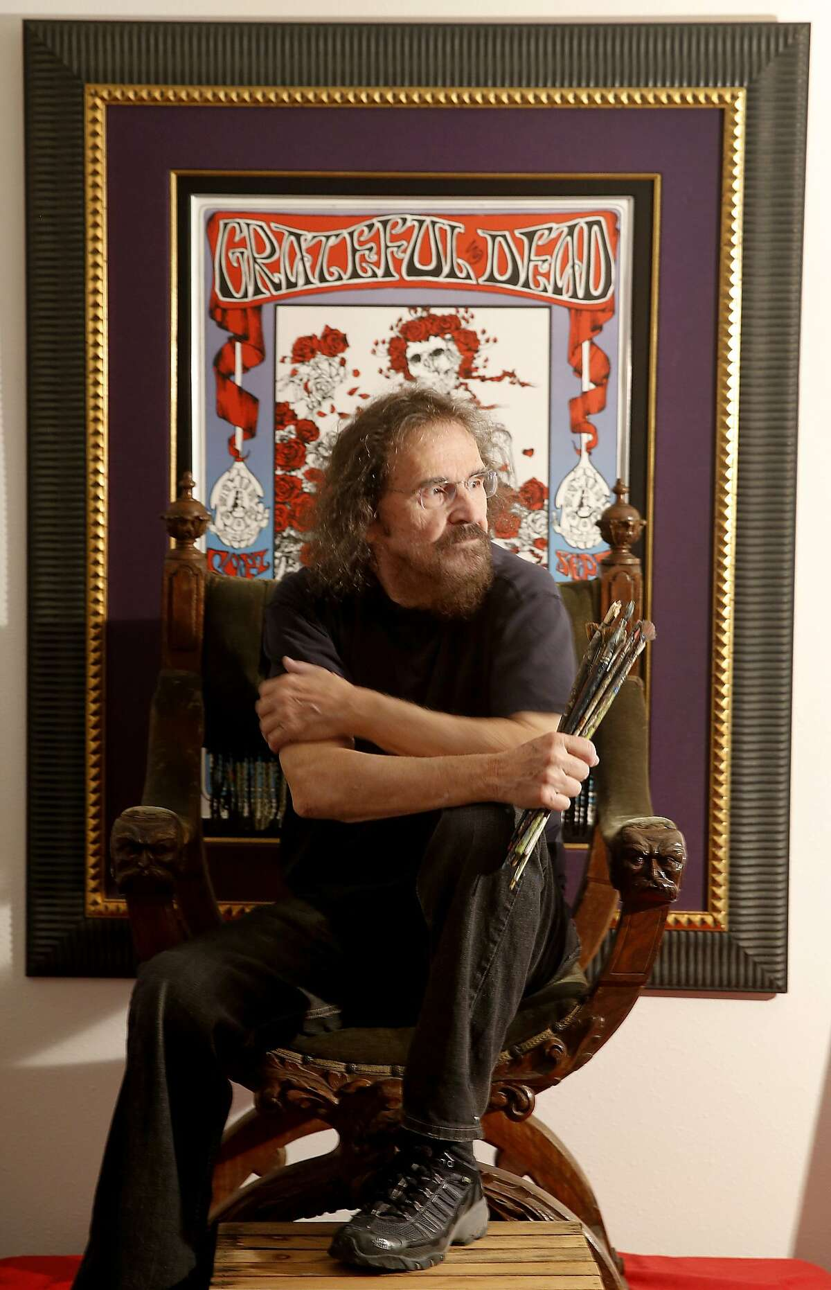 """Stanley """"Mouse"""" Miller poses in front of his famous Avalon ballroom poster from 1966 in his Sebastopol, Calif. studio. Artist Stanley """"Mouse"""" Miller is one of the most famous poster artists of the San Francisco rock era. He is out with a new art book and a 50th anniversary gallery show."""