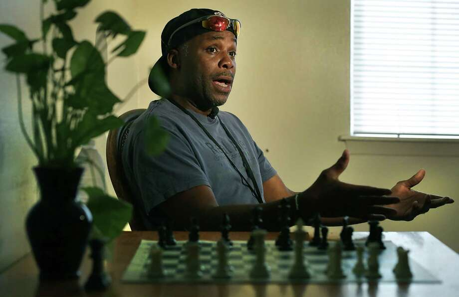 SpeakingTuesday from his table where he plays chess, Eric McNear, a 46-year-old veteran, found assistance through SAMMinistries and its Veterans Housing Stability Program to help him get off the streets and into his own apartment. Photo: Bob Owen /San Antonio Express-News / San Antonio Express-News