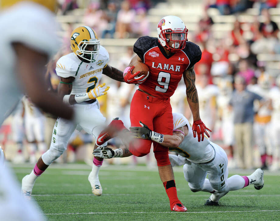 Lamar receiver Reggie Begelton was predicted by Dave Campbell Magazine to earn Player of the Year honors this season. Lamar's Reggie Begelton, No. 9, advances while Southeastern Louisiana University defenders Micah Eugene, No. 2, and Tyler Stoddard, No. 23, move in for a tackle. The Lamar Cardinals hosted the Southeastern Louisiana University Lions at Provost Umphrey Stadium on Saturday night. Photo taken Saturday 10/11/14 Jake Daniels/@JakeD_in_SETX   Manditory Credit, No Sales, Mags Out, TV OUT, Web: AP Members Only Photo: Jake Daniels / ©2014 The Beaumont Enterprise/Jake Daniels